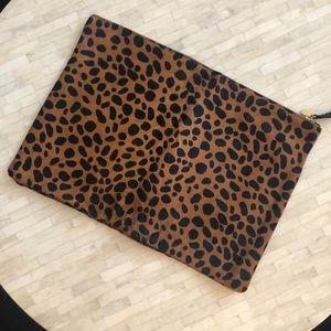 Clare V oversized leopard pony hair clutch
